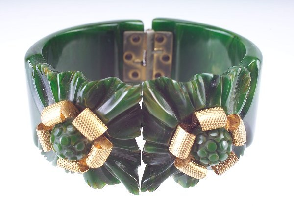 23: Carved marbleized green bakelite hinged bangle with