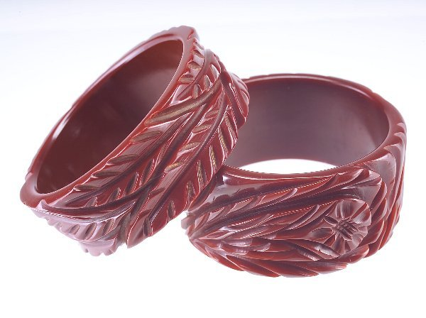 24: Two deeply-carved bakelite bangles, both in rich br
