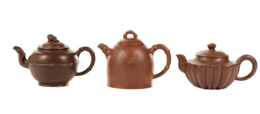 Three Yixing Zisha Teapots, Two Red and One Brown
