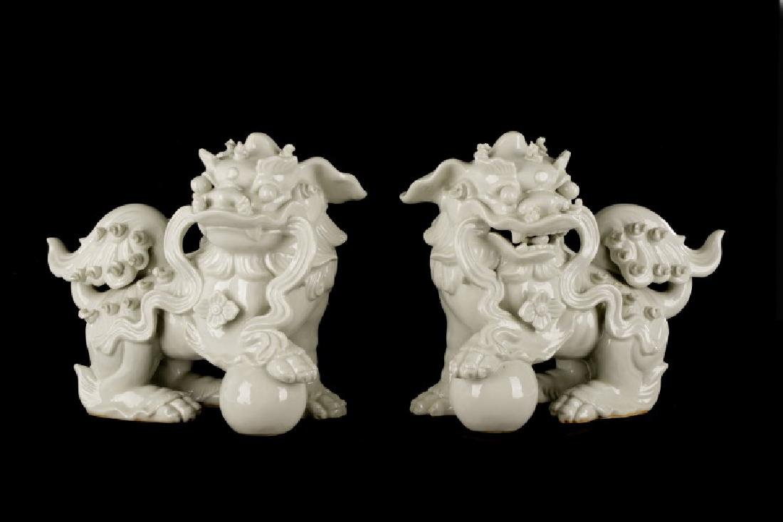 Pair, Chinese Blanc de Chine Foo Dogs