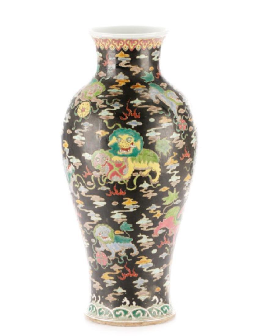Chinese Famille Noir Porcelain Fu Dog Motif Vase