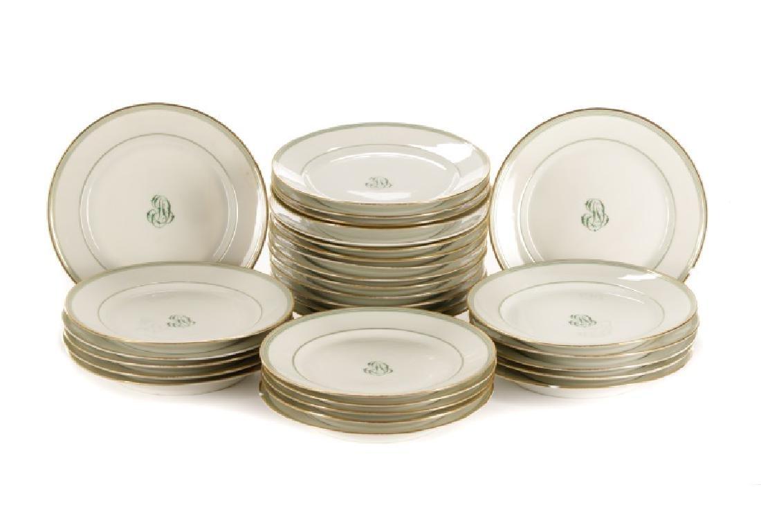 31 Monogrammed Green & Gilt Porcelain Plates