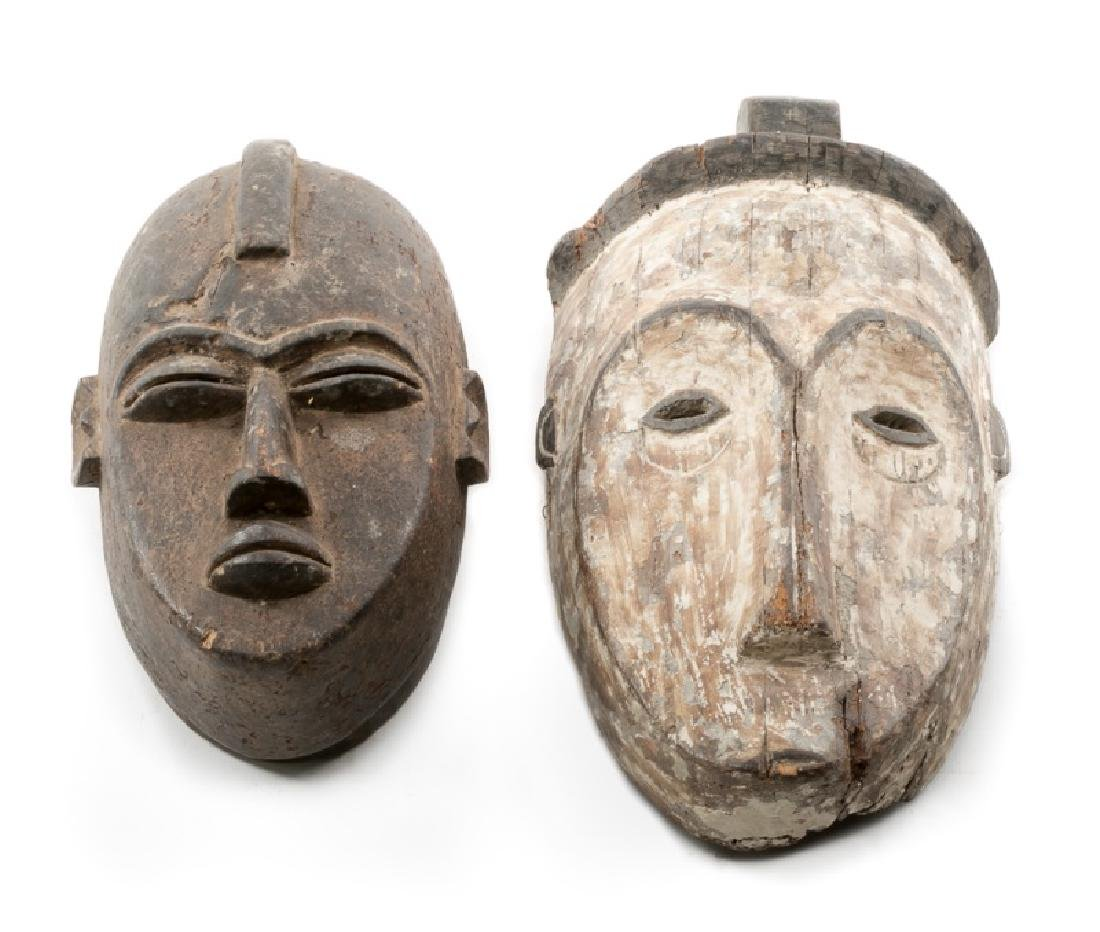 Group of 2 Carved Wood Elongated African Masks