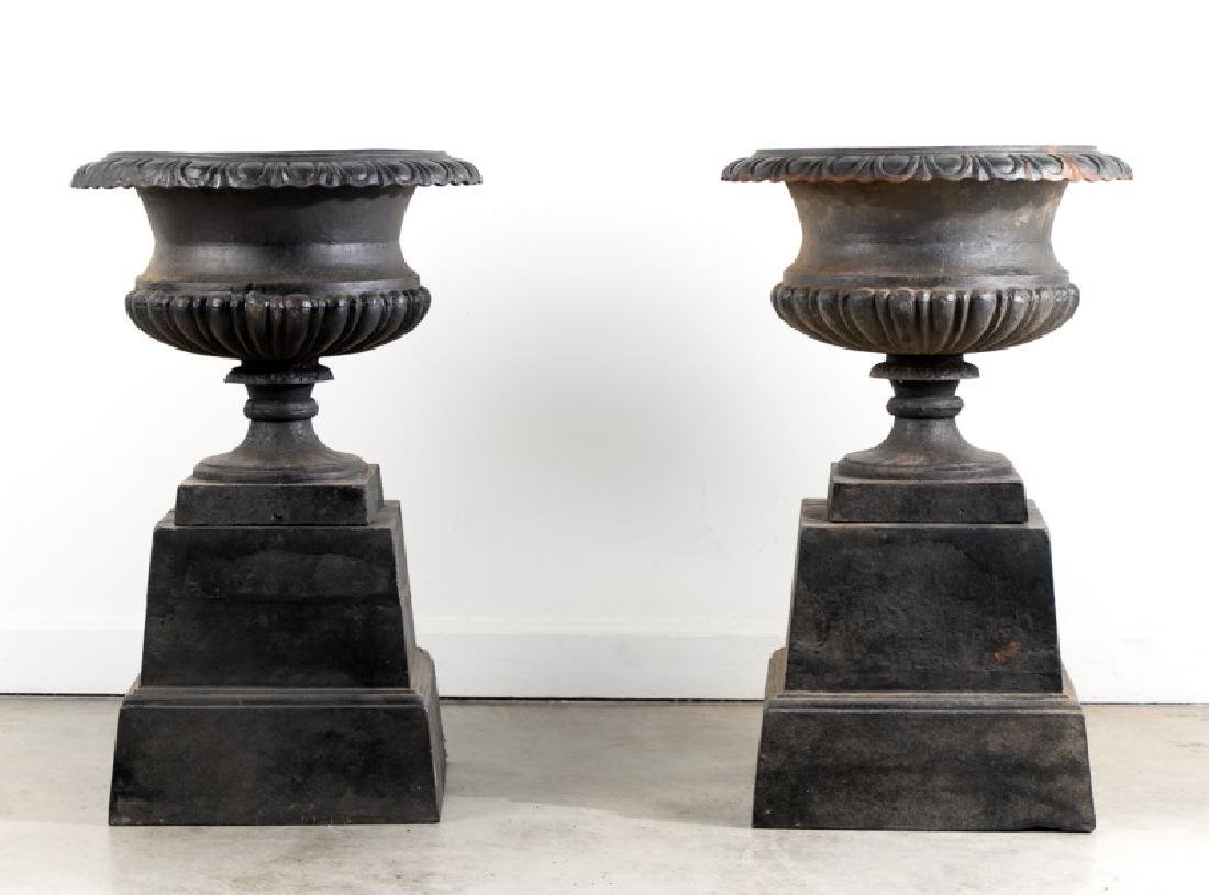 Pair of Black Wrought Iron Urns on Bases