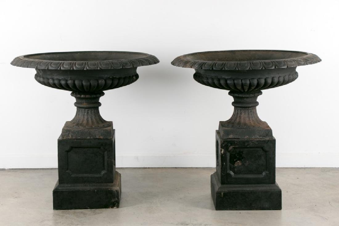 Pair of Large Black Wrought Iron Urns on Bases