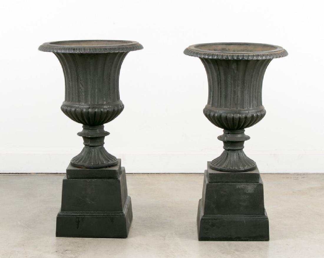 Pair of Black Wrought Iron Garden Urns on Bases