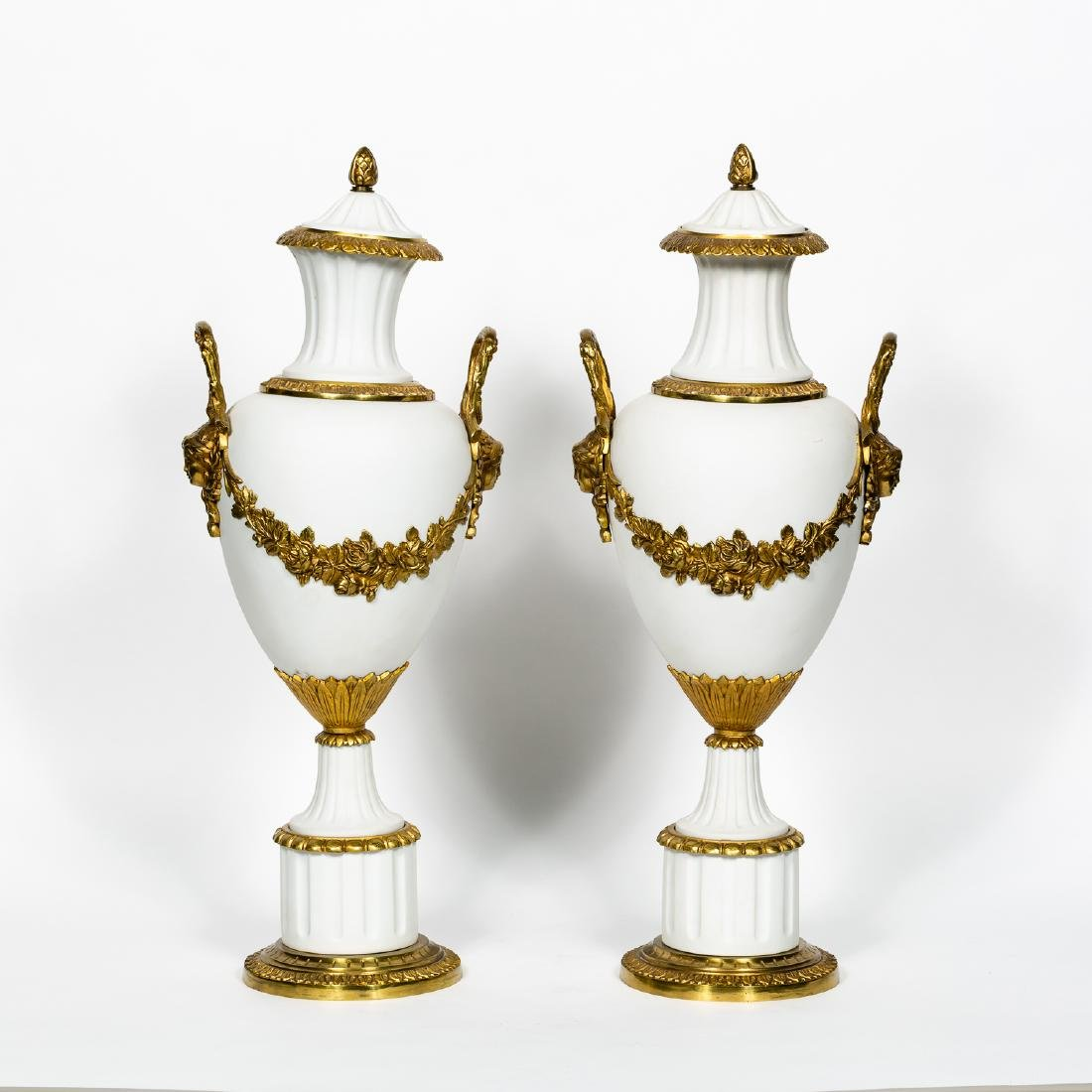Pair of Neoclassical Bisque & Brass Accented Urns