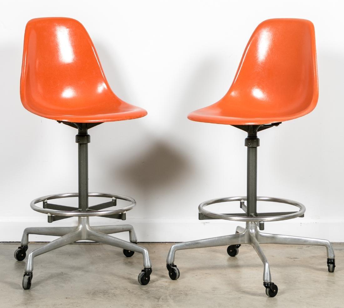 Pair of Herman Miller Orange Drafting Stools