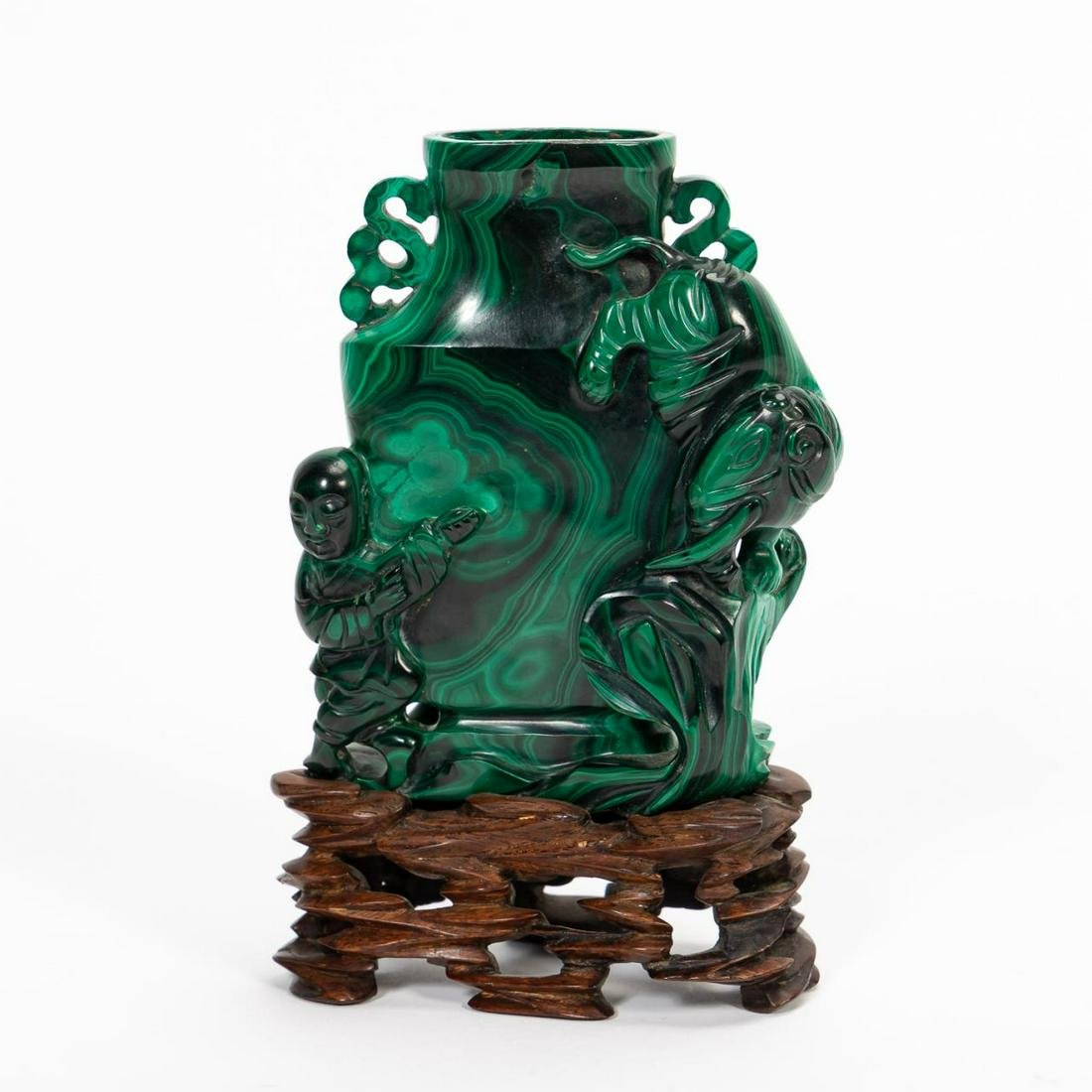 CHINESE, CARVED FIGURAL MALACHITE VASE ON STAND
