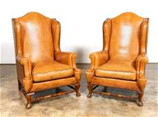 PAIR CARAMEL LEATHER WING BACK CHAIRS