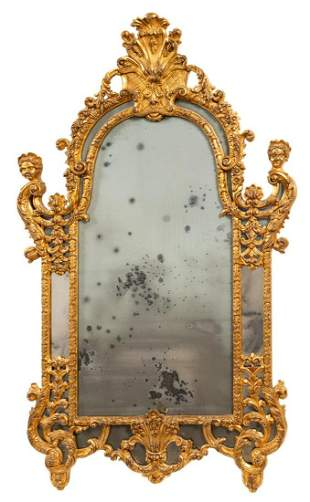 LARGE ROCOCO STYLE SHELL MOTIF GILTWOOD MIRROR