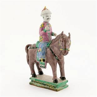 CHINESE BISCUIT GLAZED FIGURE ON HORSEBACK