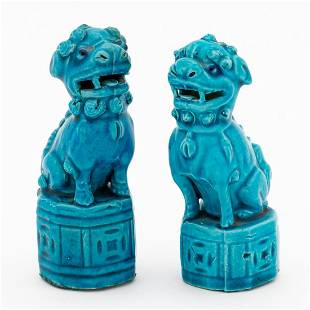 SMALL PAIR OF PEACOCK-BLUE CERAMIC BUDDHIST LIONS