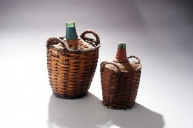 Pair of Glass Wine Jars in Baskets.