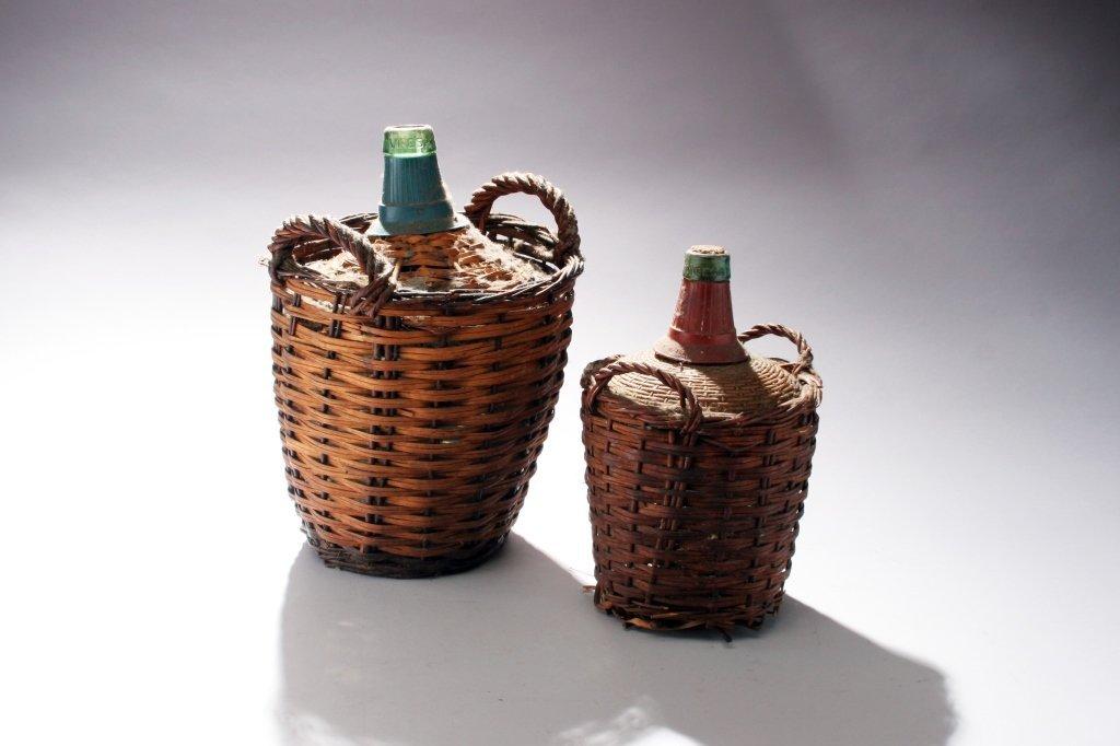 Pair of Glass Wine Jars in Baskets.