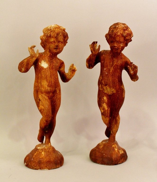 A Pair of Cast Iron Wingless Putti Figures