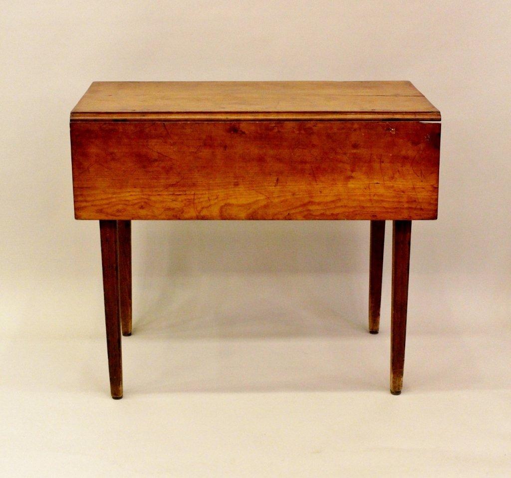 An Early 19th C. American Mahogany Pembroke Table.
