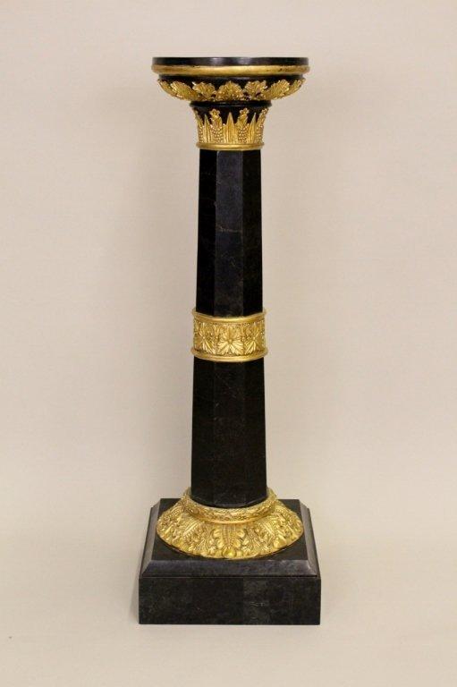 A Black Marble & Gilt Wood Pedestal.