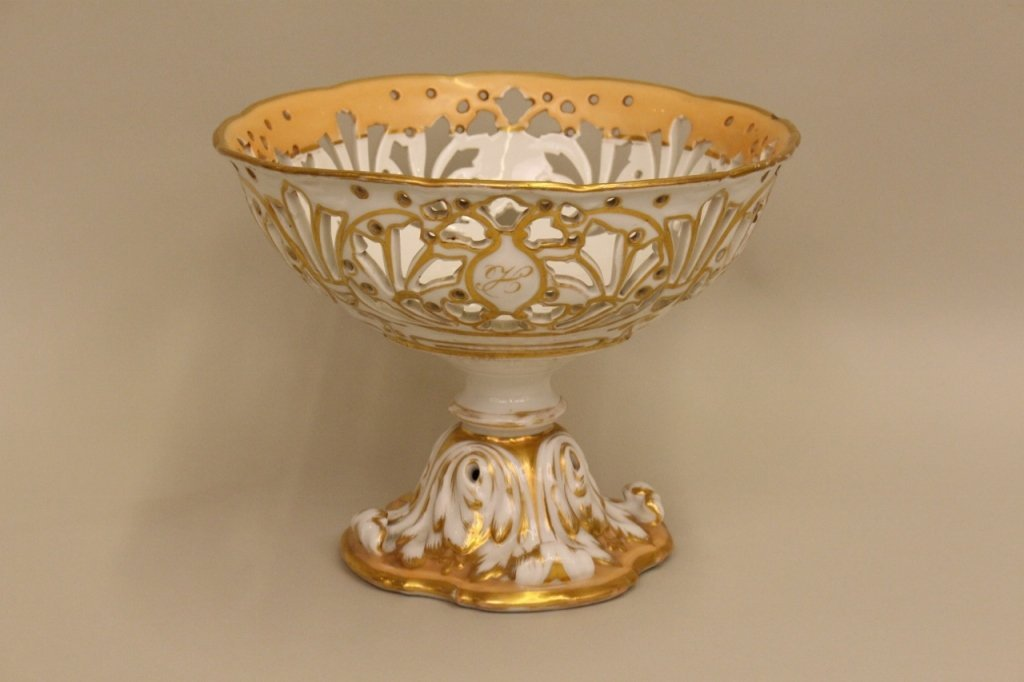A Footed Openwork Compote in White and Peach.