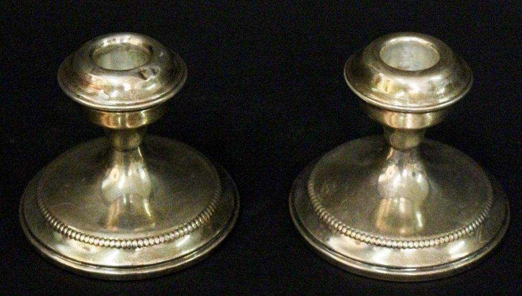 Pair of Sterling Cement Reinforced Candlesticks
