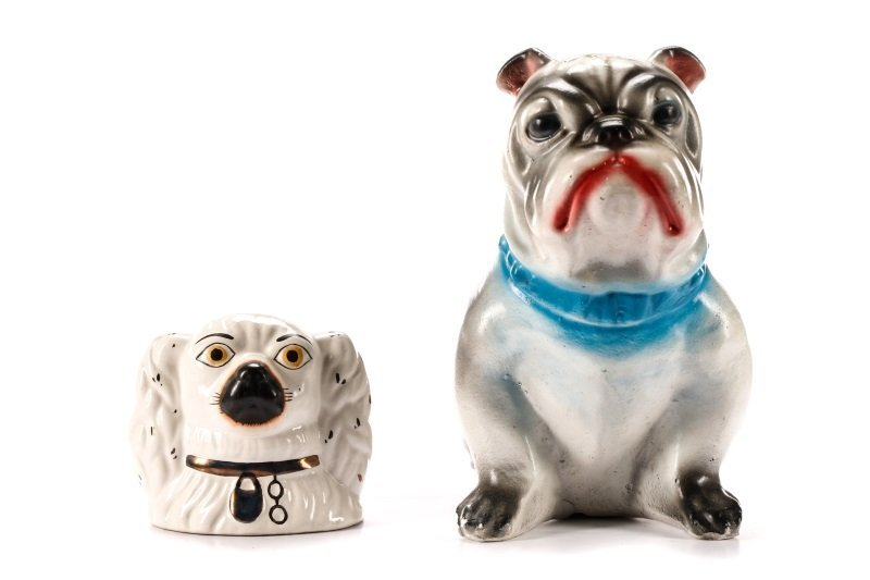 Two English Pottery Dog Form Piggy Banks