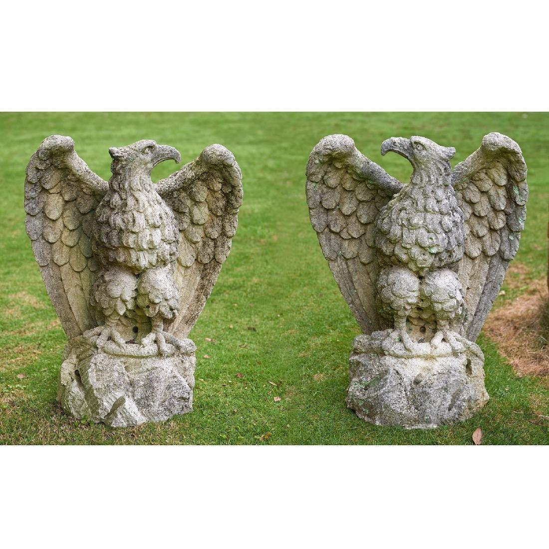 Pair antique cast stone eagles