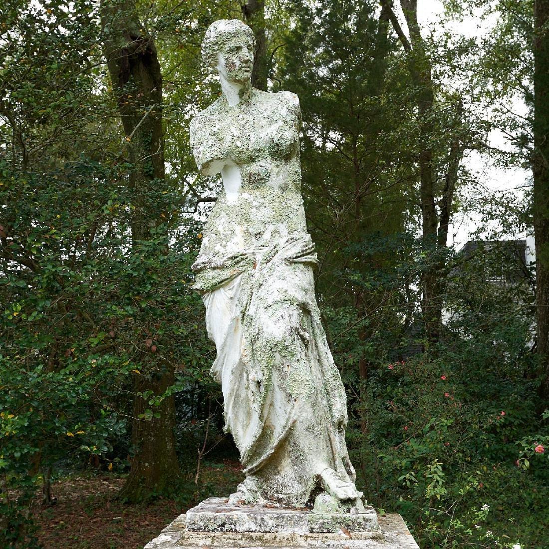 Life-size antique cast iron garden figure