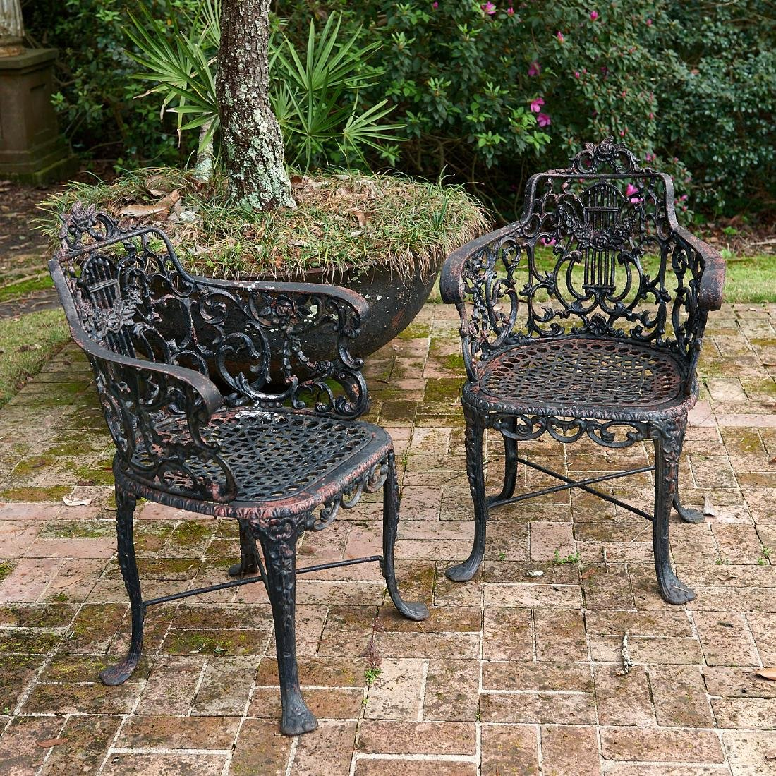 Pair Victorian cast iron lyre back armchairs