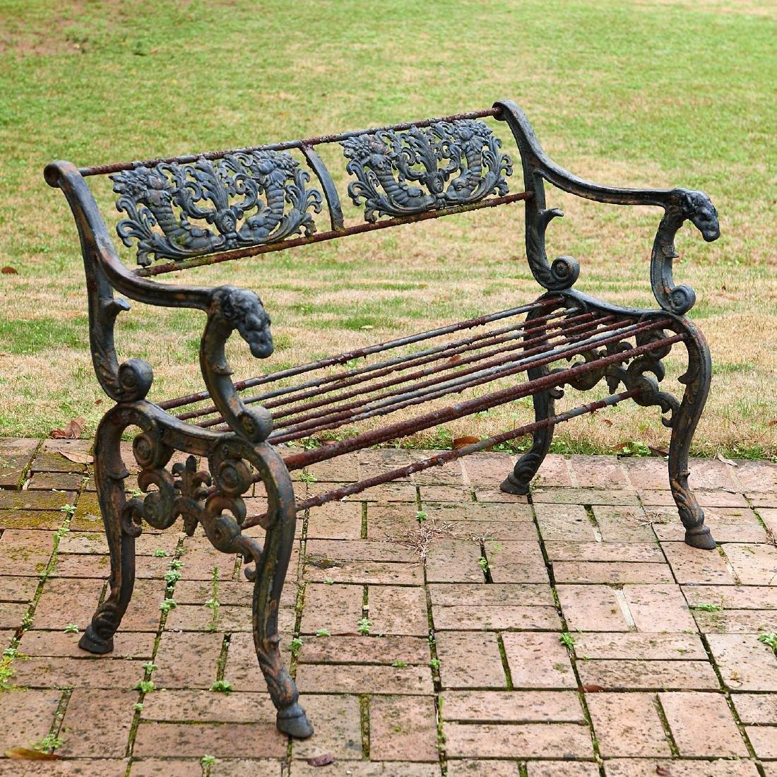 Antique painted cast iron garden bench
