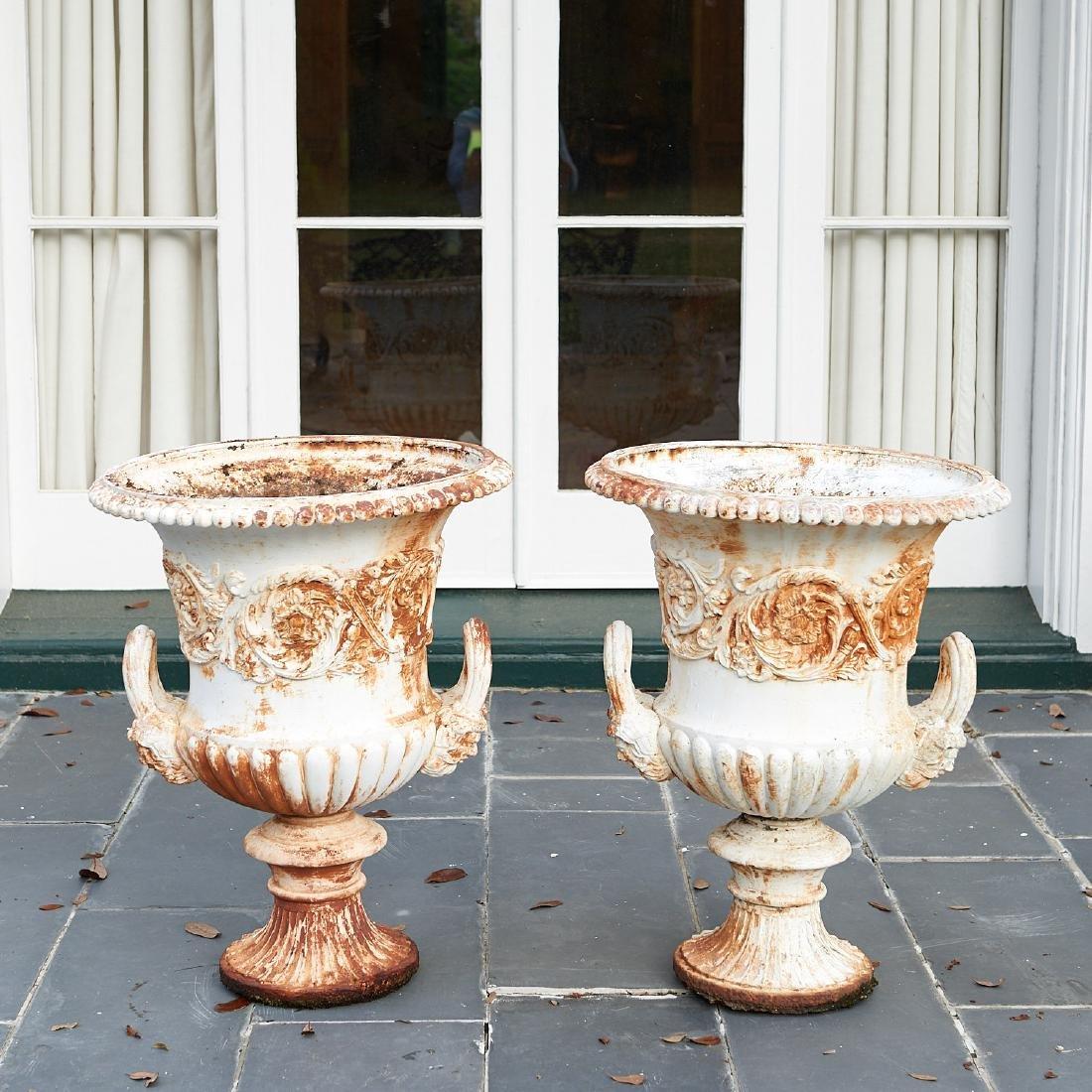 Pair old cast iron garden urns
