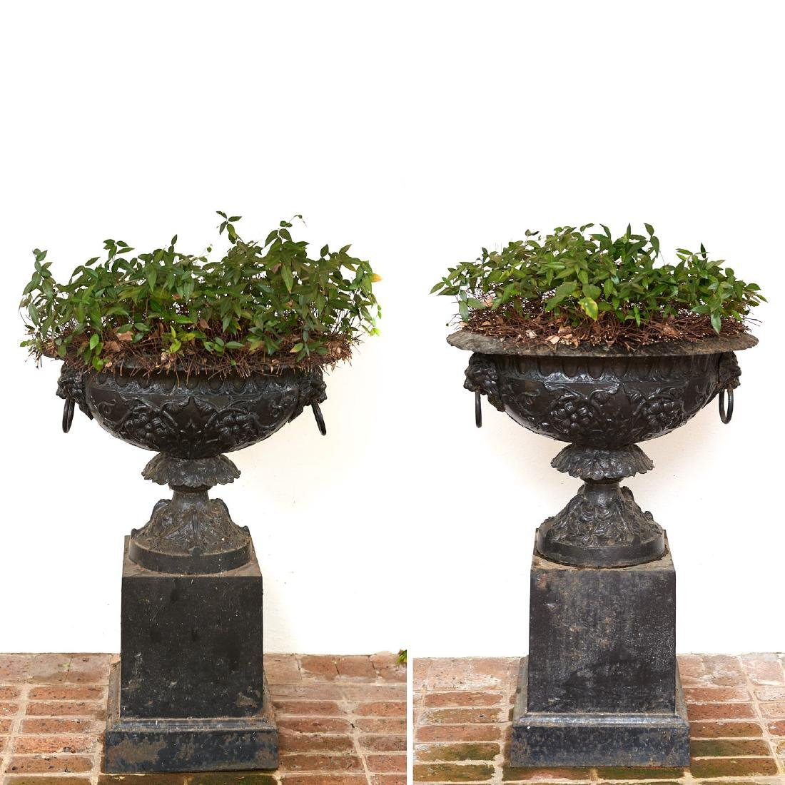 Pair old black painted cast iron garden urns