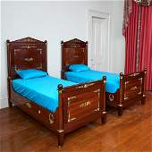 Pair Empire style ormolu mounted mahogany beds