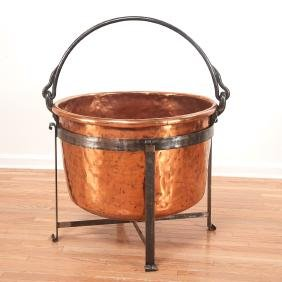 Large copper cauldron on wrought iron stand