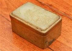 Chinese jade plaque mounted in gilt metal box