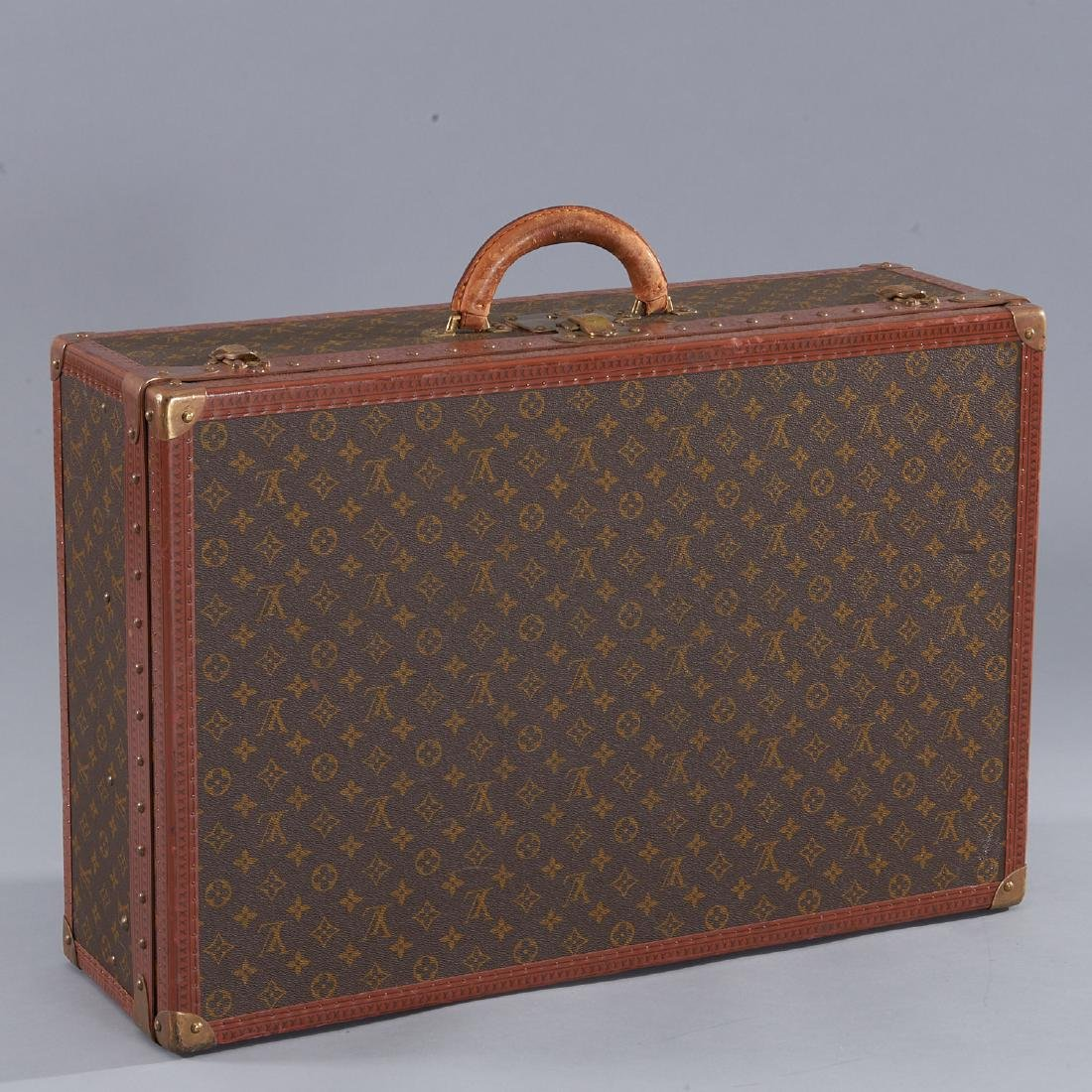 Louis Vuitton Monogram hard sided suitcase
