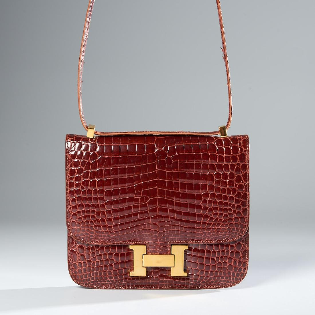 Kwanpen brown crocodile handbag