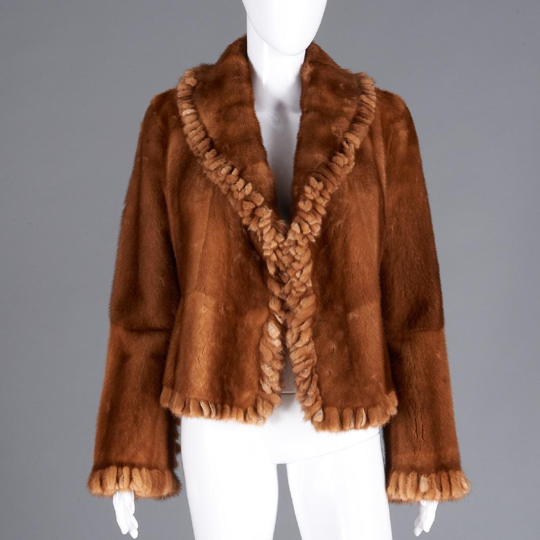 Golden fur reversible jacket with fringed detail