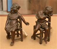 Pair patinated bronze figures of seated children