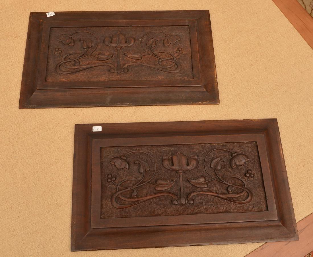 Pair Art Nouveau carved walnut relief panels