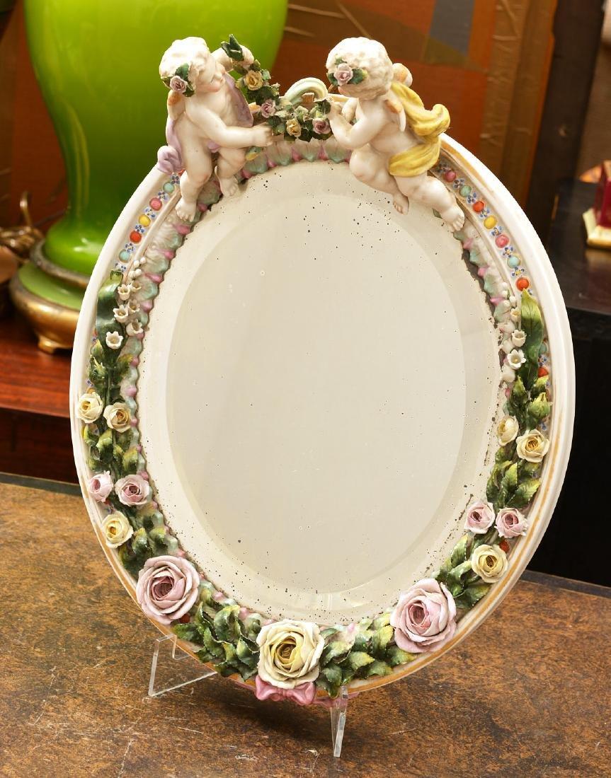 Meissen style hand-painted porcelain cherub mirror