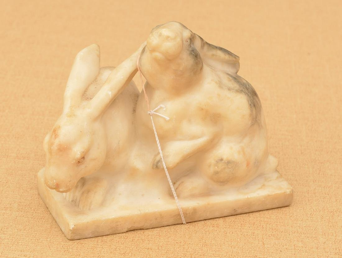 Carved white marble rabbit group