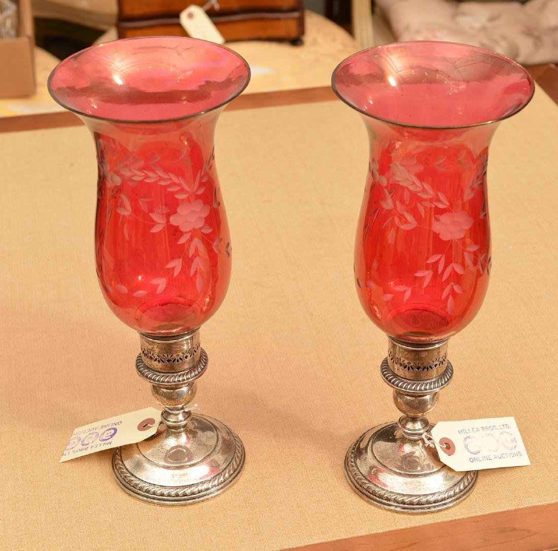 Gorham silver candleholders with cranberry shades