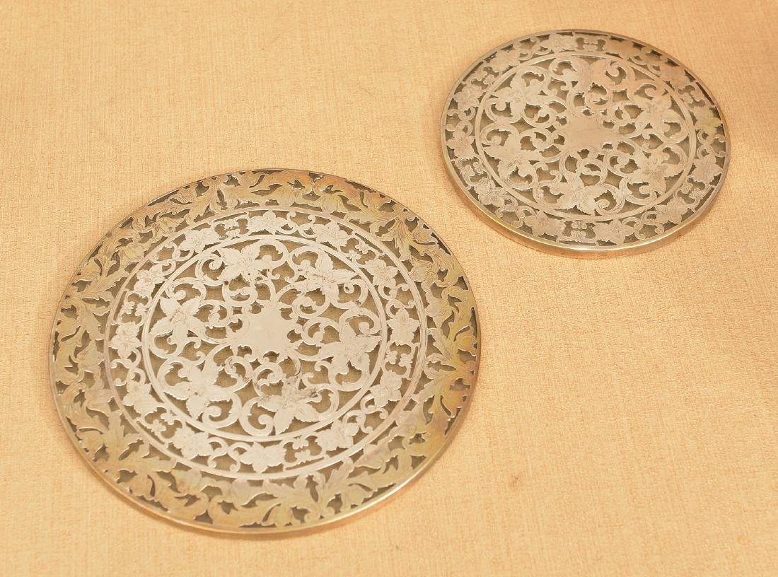 (2) nice Webster sterling overlay glass trivets