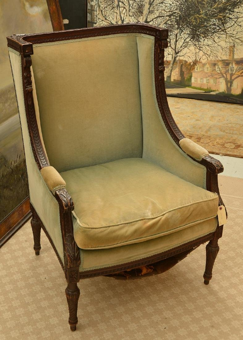 Richly carved French upholstered bergere