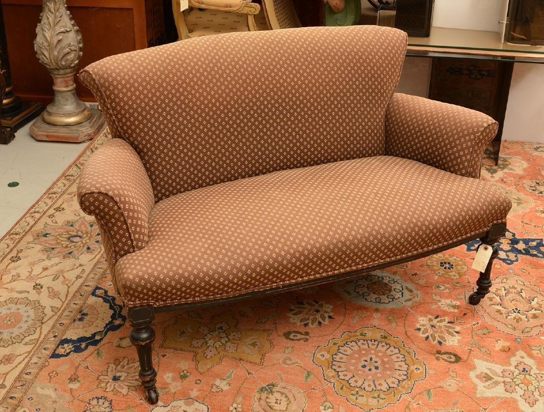 Napoleon III ebonized upholstered settee