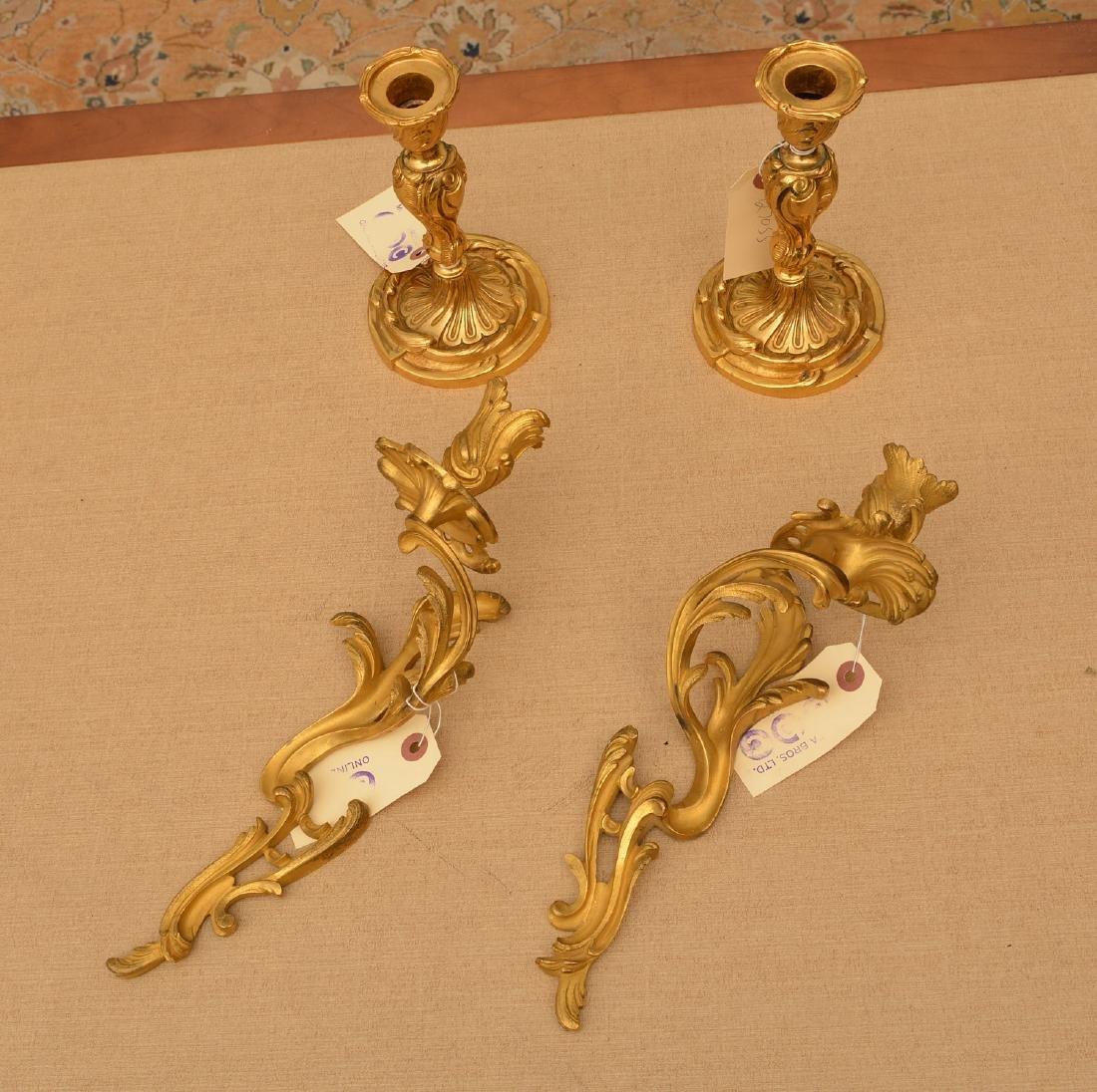 Louis XV style ormolu candlesticks and sconces