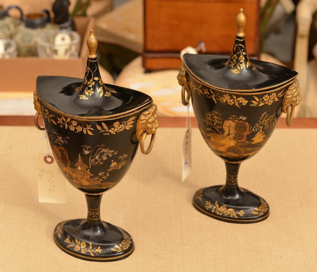 Pair Regency style black tole chestnut urns