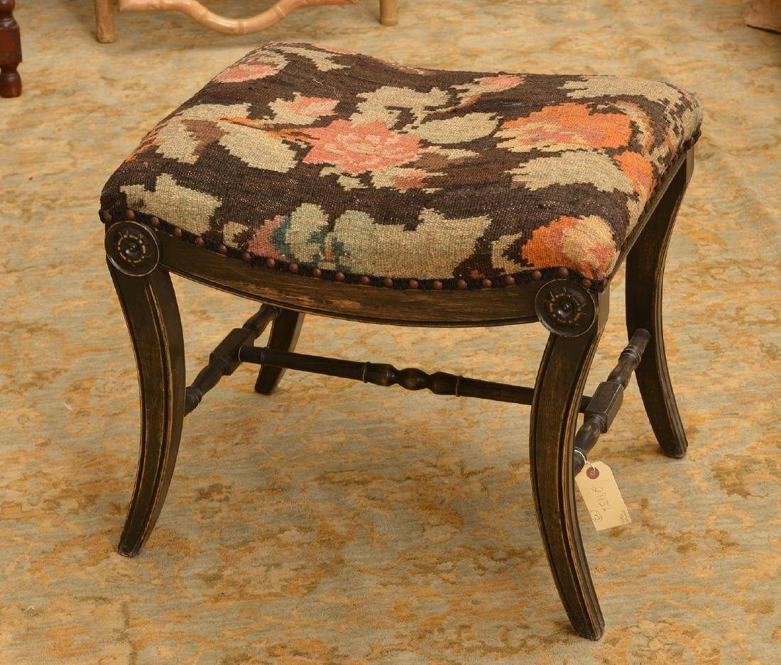 Regency style ebonized bench with kilim seat