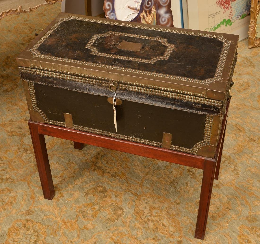 Chinese Export tacked leather trunk on stand