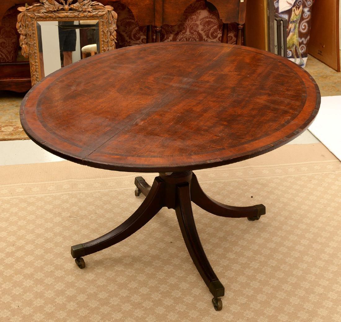 Regency banded mahogany breakfast table